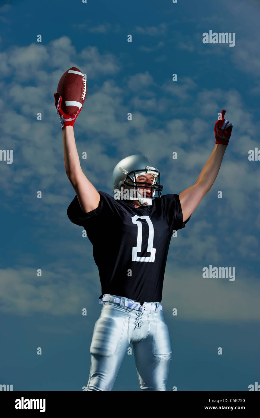 American Football player celebrates. - Stock Image