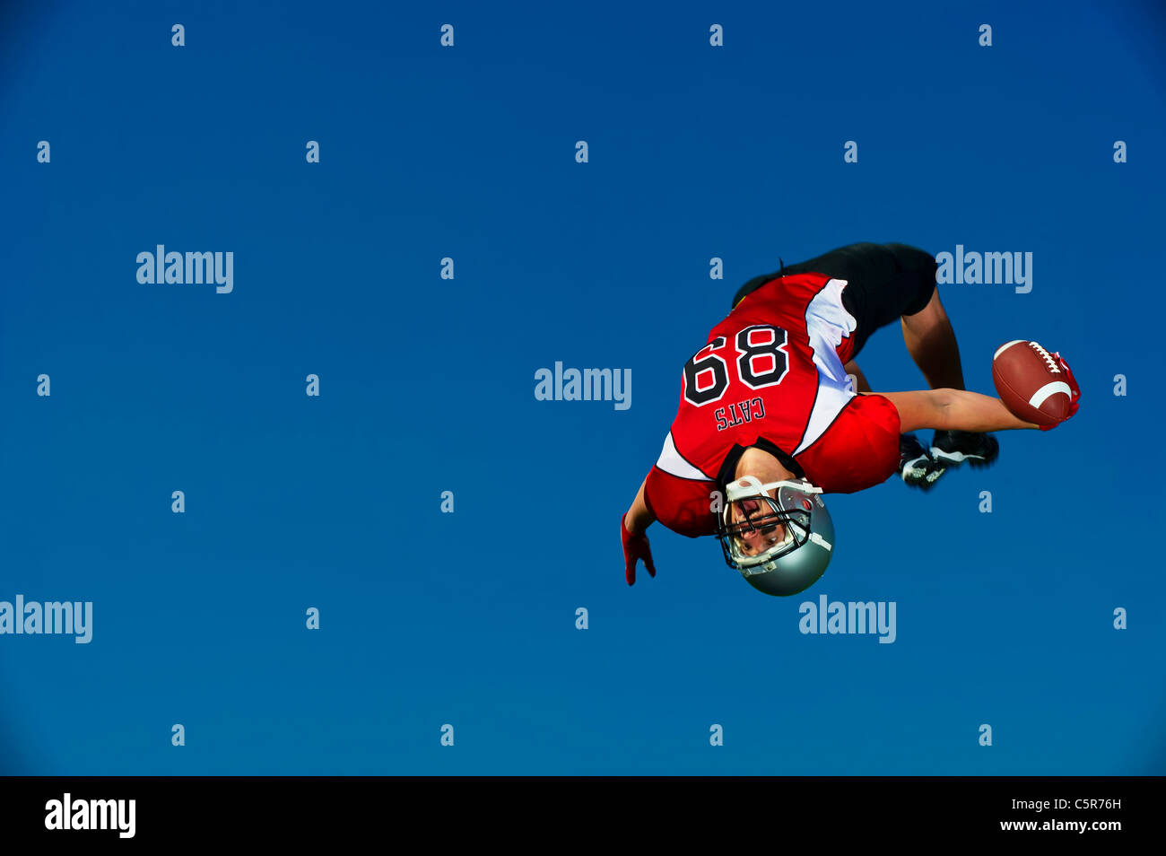 American Football player celebrates touchdown - Stock Image