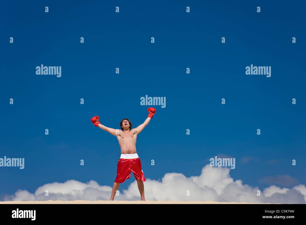 A boxer celebrates on cloud nine. - Stock Image