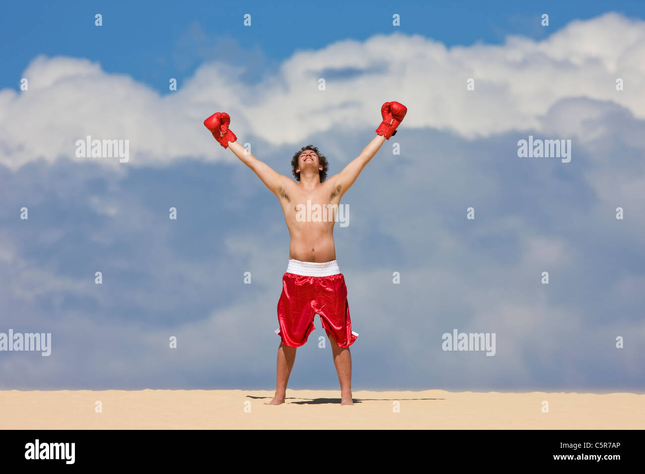 A boxer celebrating on top of the World. - Stock Image
