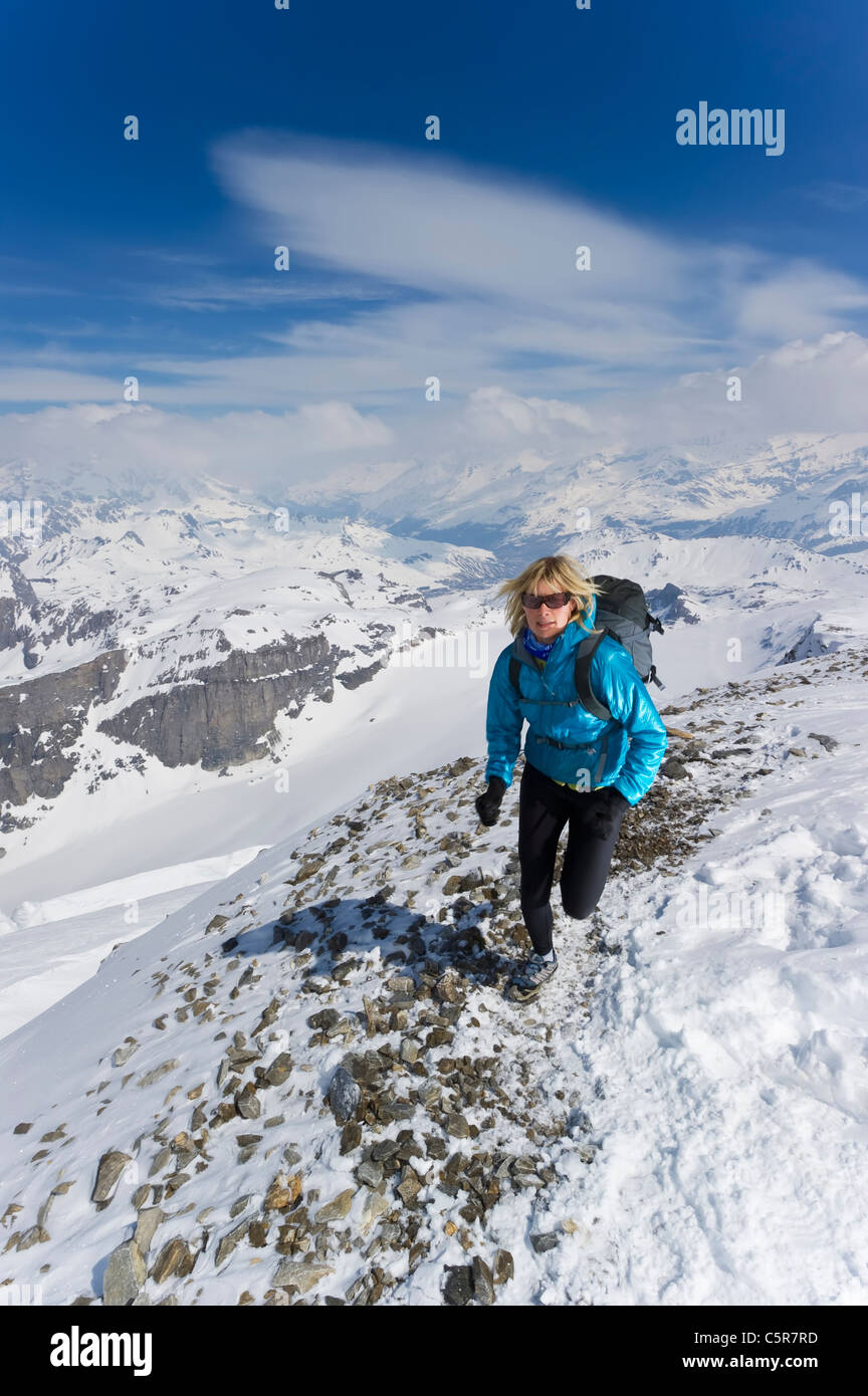 A women jogging on high Alpine mountains. - Stock Image