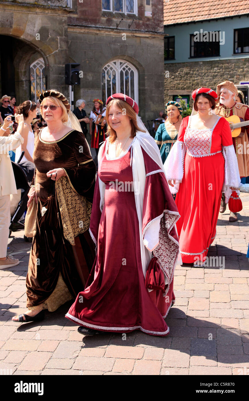 Procession of people dressed in Medieval costumes during Shaftsbury's Gold Hill Fair Dorset - Stock Image