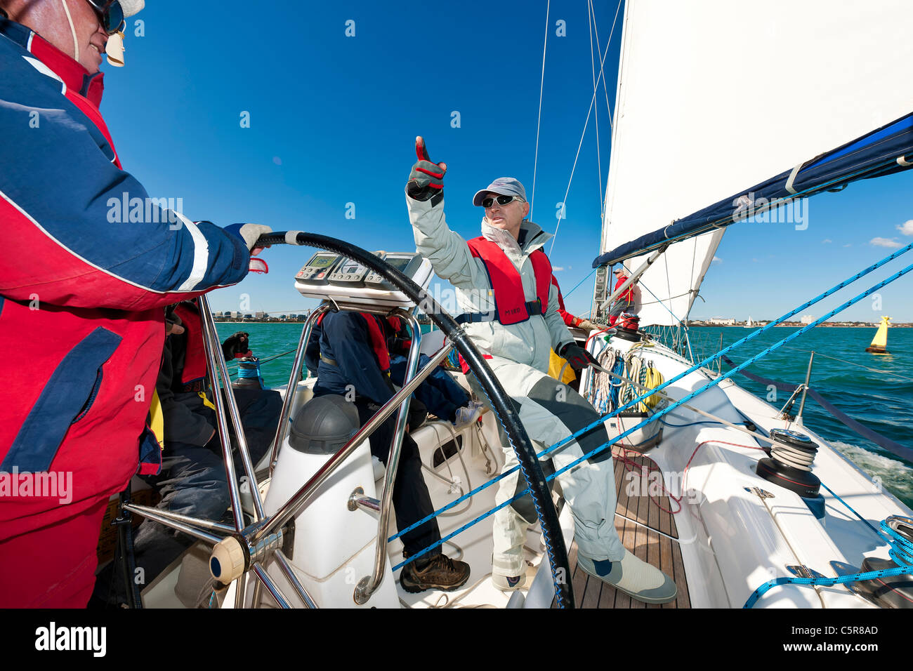 An Offshore Yacht crew getting ready to race. - Stock Image