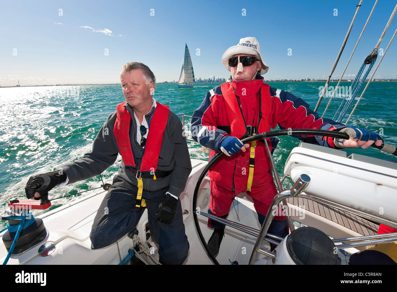 The captain is steering an Ocean going yacht. - Stock Image