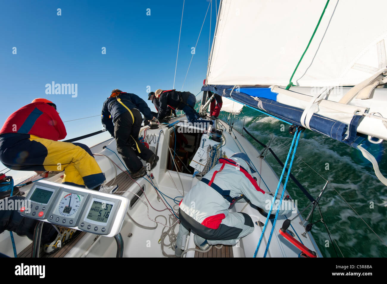 'Teamwork' as shown by an offshore yacht Racing crew. - Stock Image