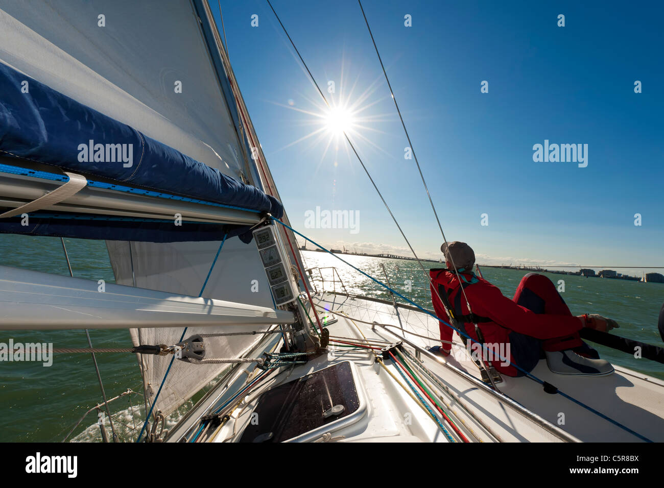 Man relaxing on yacht in the sun. - Stock Image