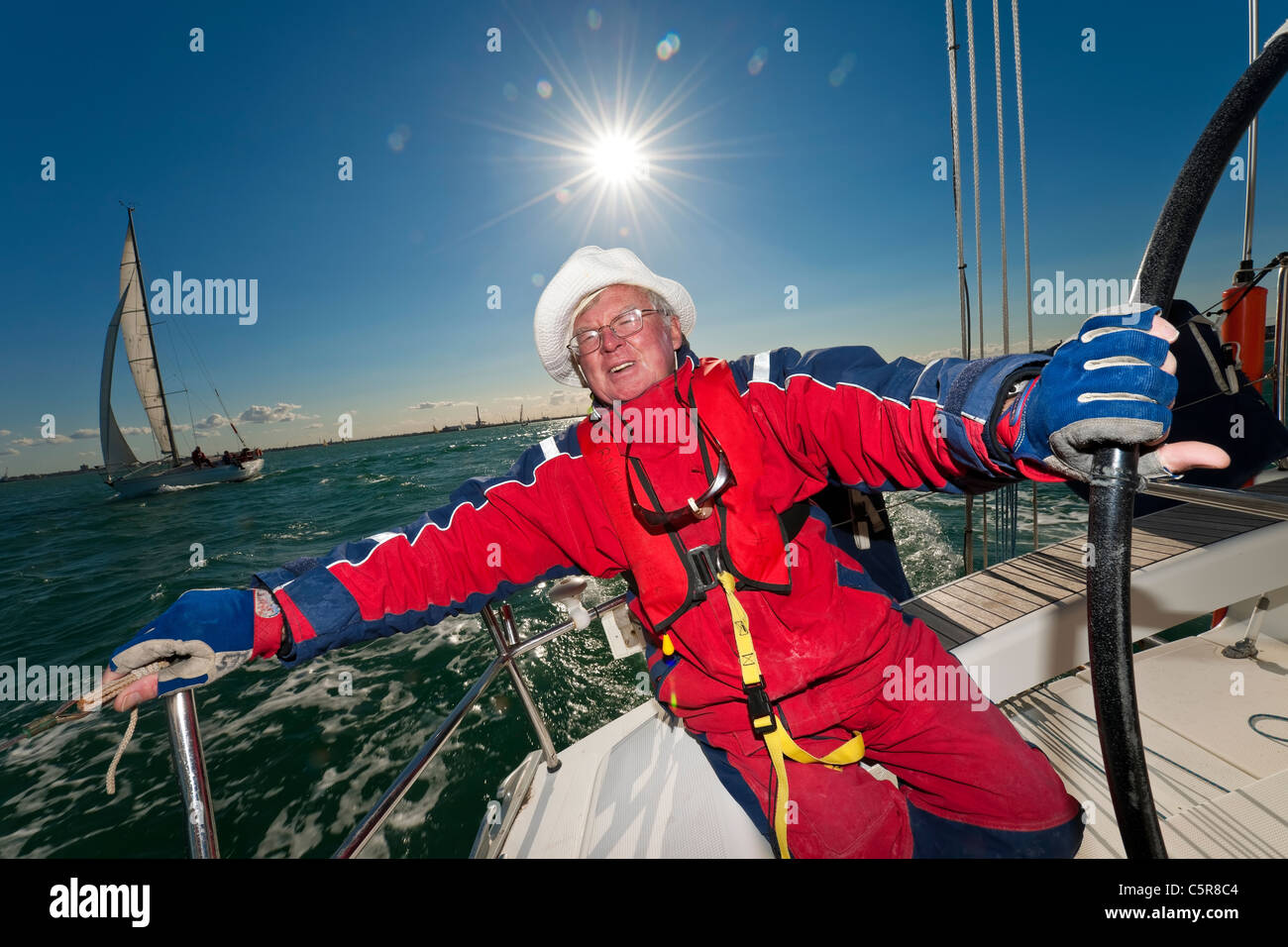 The captain at the wheel of an Ocean going yacht. - Stock Image