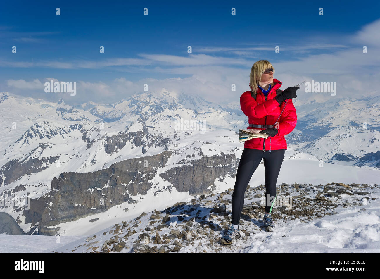 A women orienteering in high altitude mountains. - Stock Image