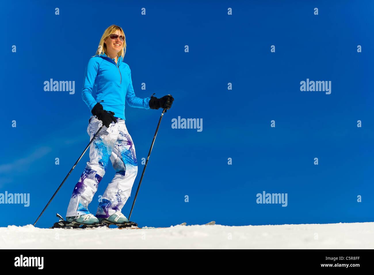A woman enjoying her skiing holiday. - Stock Image