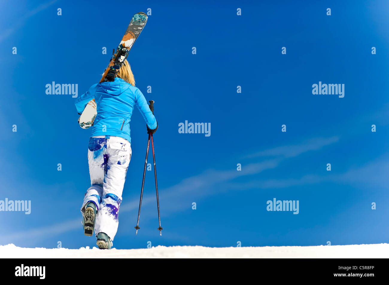 A female skier on the piste. - Stock Image