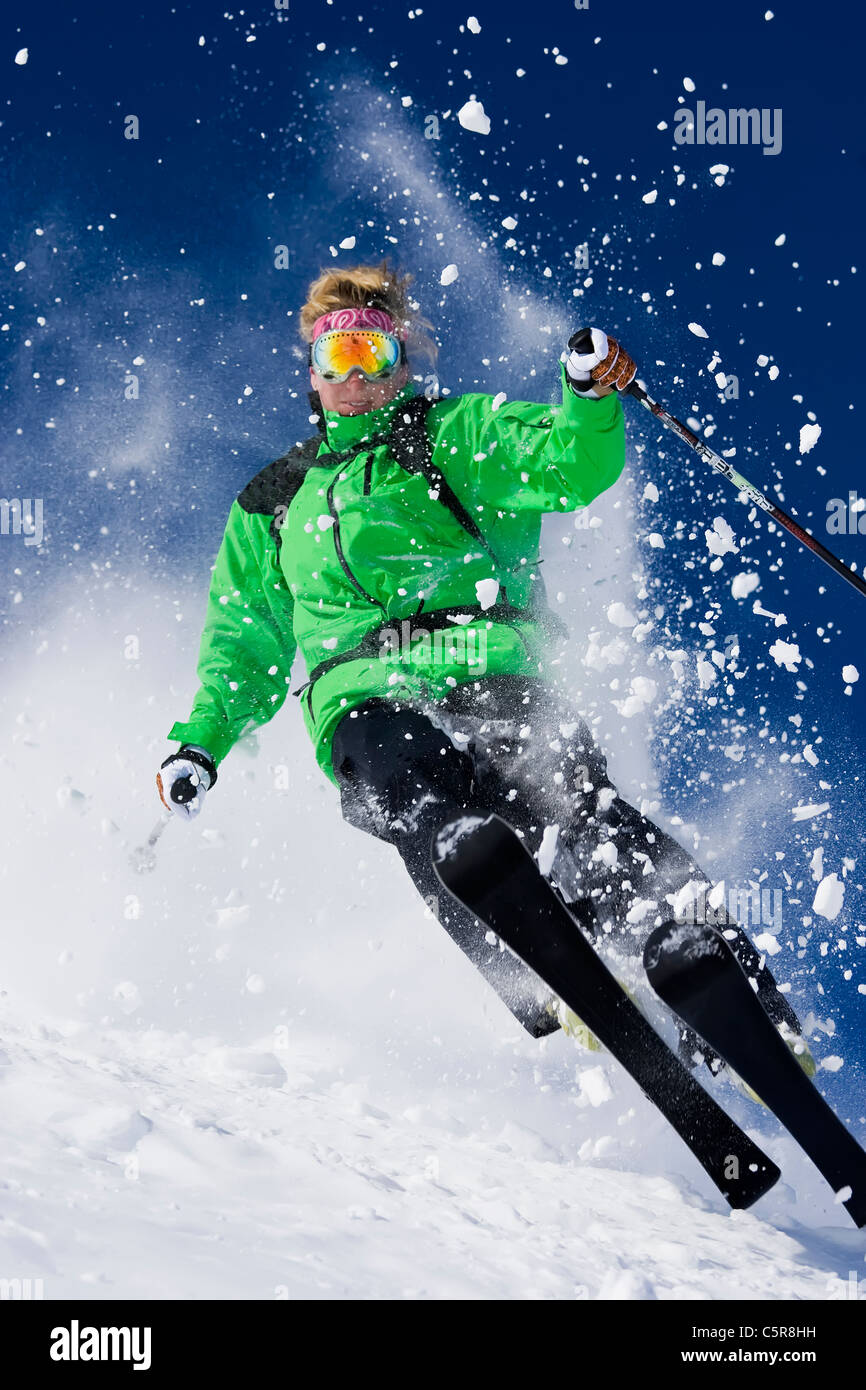 A skier explodes through the powder snow. Stock Photo