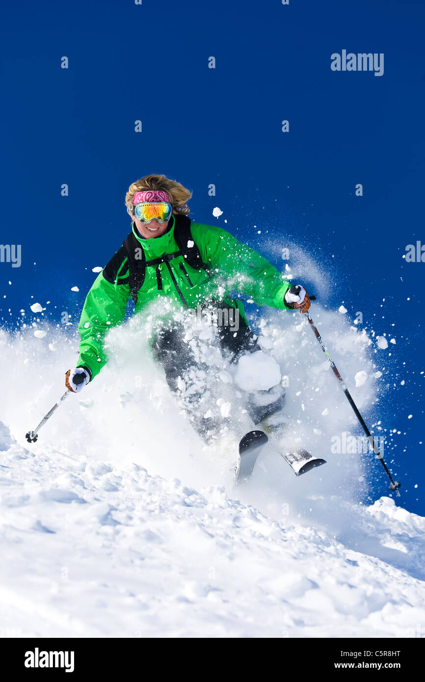 A skier skis fast off piste. - Stock Image