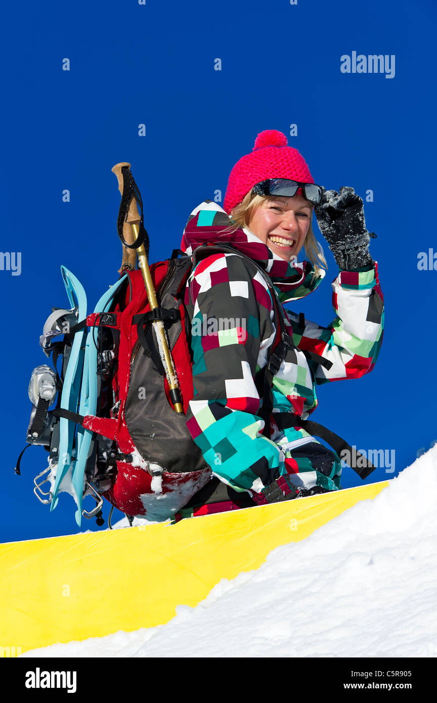 A snowboarder having fun in the snow. - Stock Image
