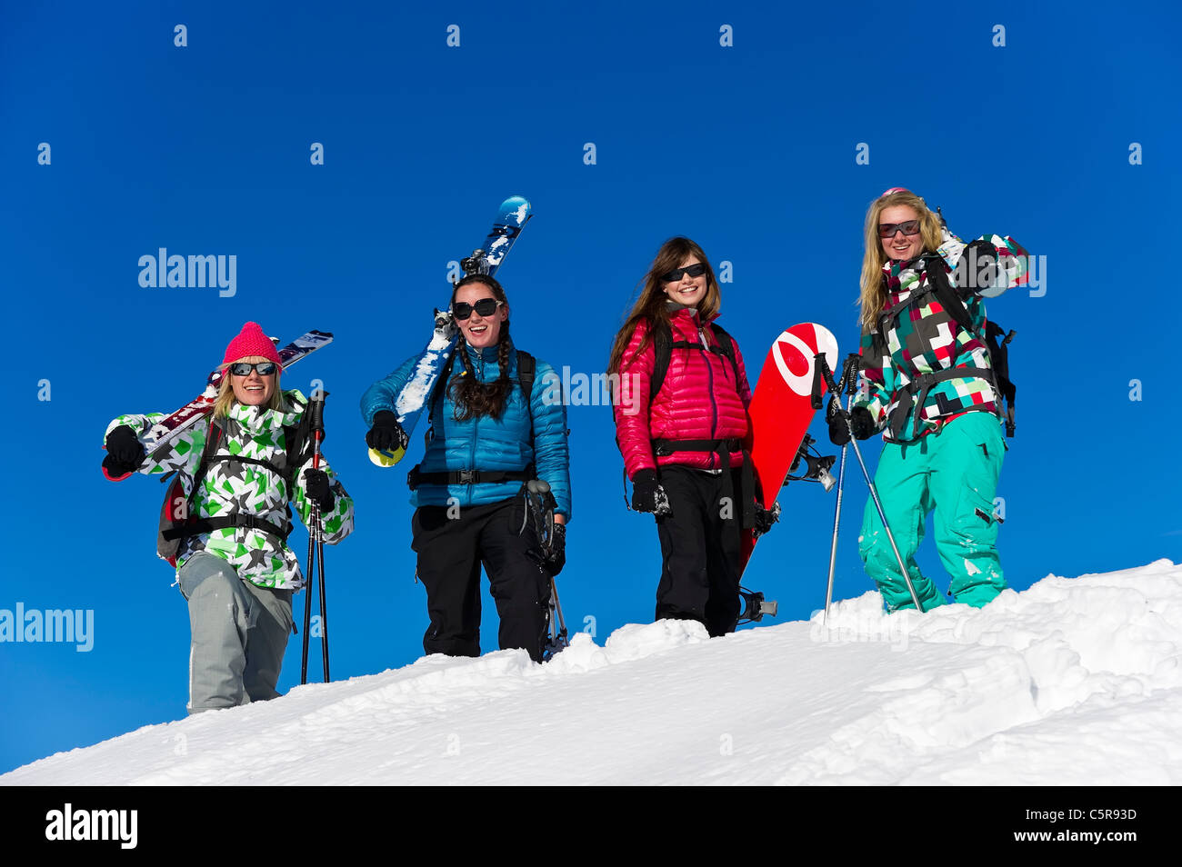 The girls having fun on a winter sports holiday. Stock Photo