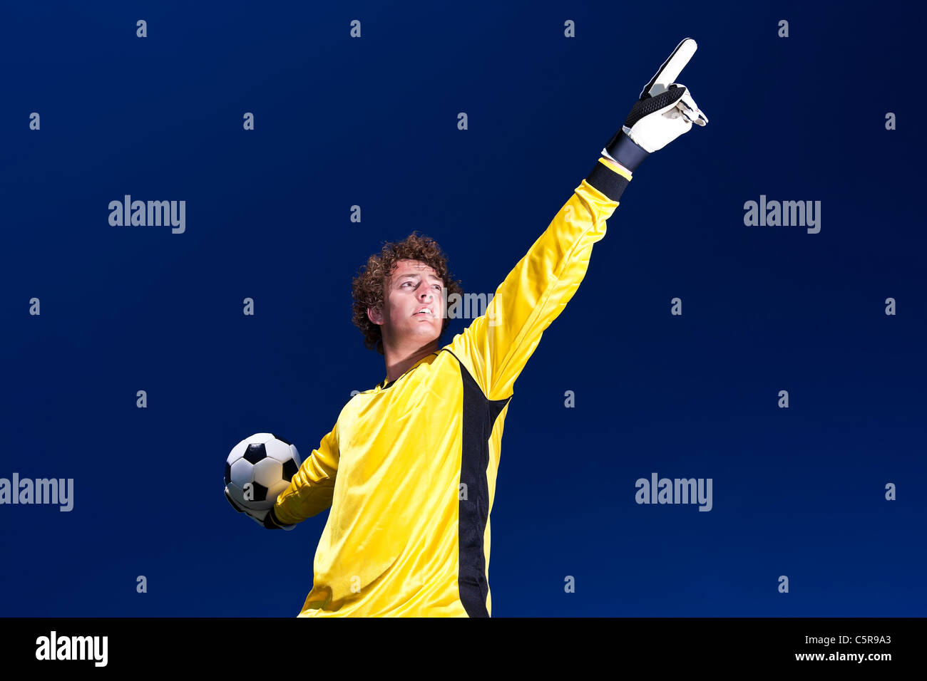 A goalkeeper gets ready to deliver ball. - Stock Image