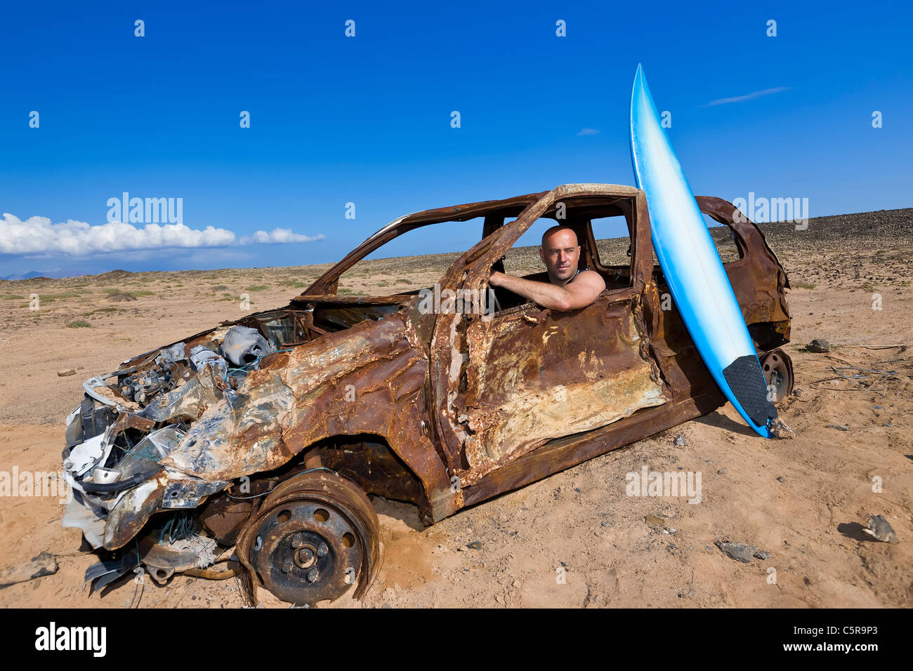 Surfer needs a new set of wheels. - Stock Image