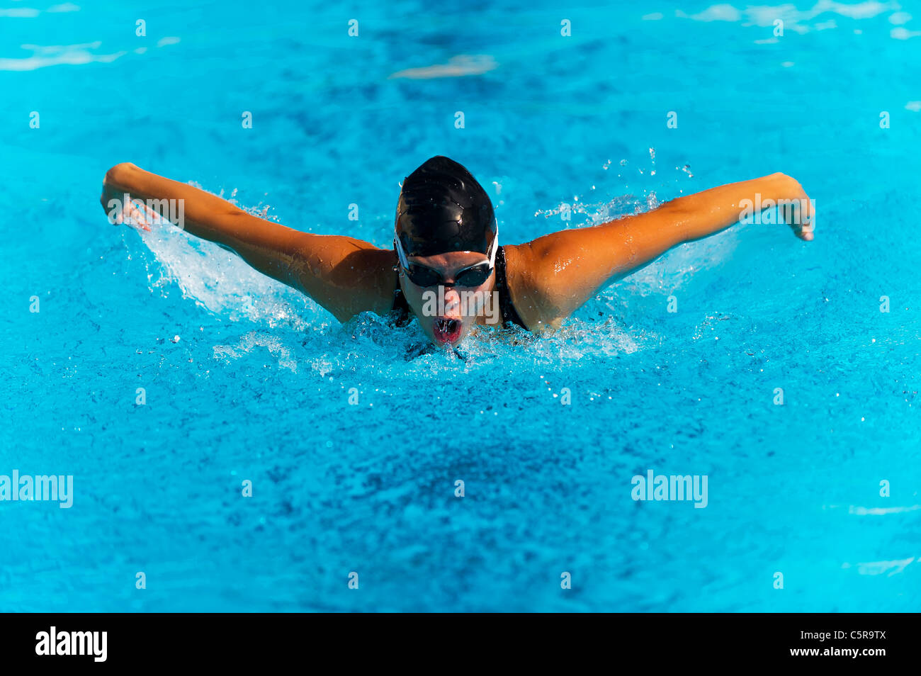 A swimmer doing the Butterfly. - Stock Image