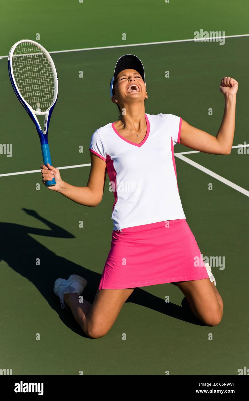 Tennis player celebrates - Stock Image