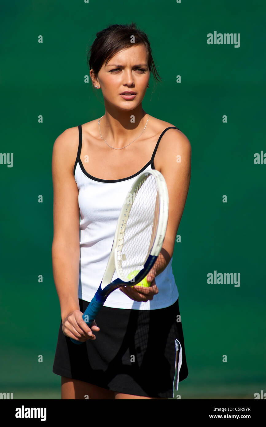 Tennis player gets ready to serve. - Stock Image