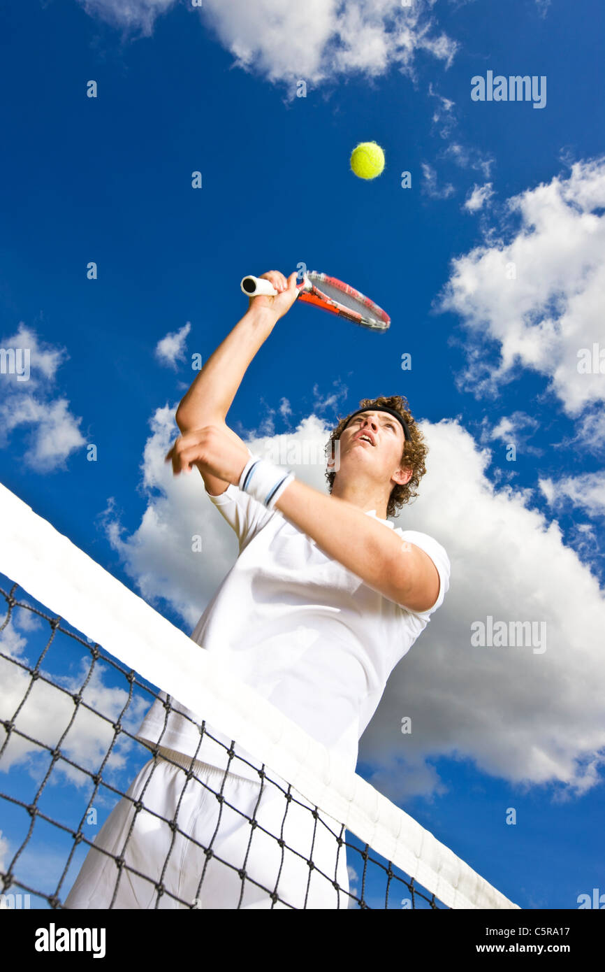 A tennis player at the net gets ready to win the point. - Stock Image