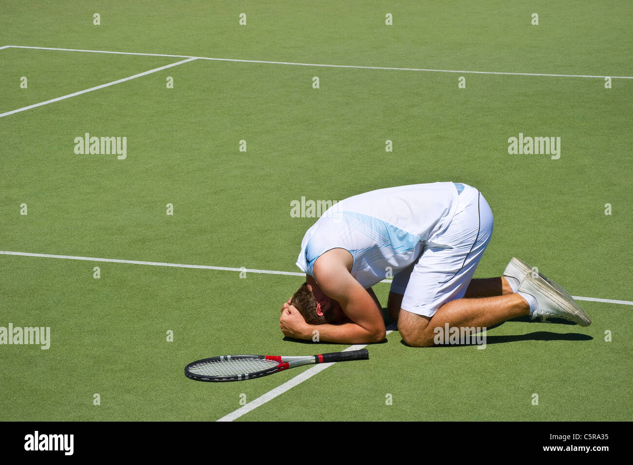 This tennis player injured on court. - Stock Image