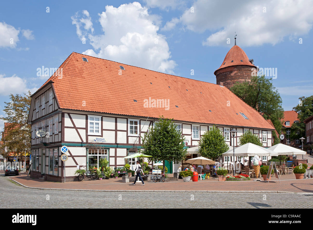 half-timbered house and Waldemar Tower, Dannenberg, Lower Saxony, Germany - Stock Image