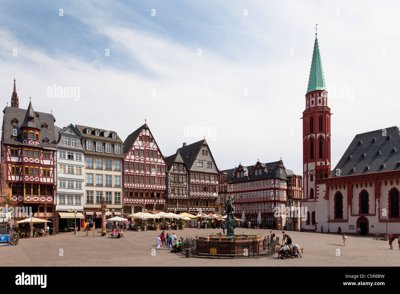 Germany, Hesse, Frankfurt, Roemerberg, View of Lady Justice statue with timberframe houses at city square - Stock Image