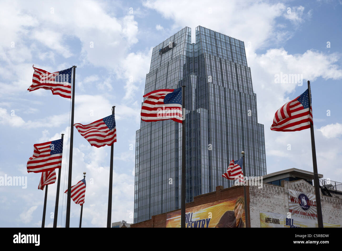us flags flying in front of the pinnacle building downtown Nashville Tennessee USA - Stock Image