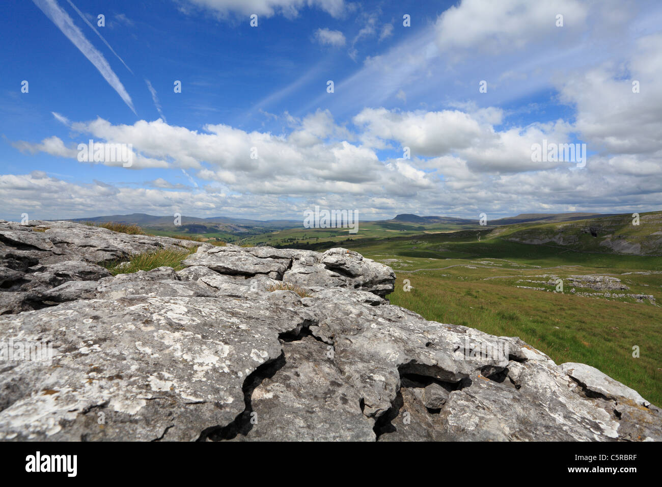 The three peaks of the Yorkshire Dales and limestone pavement. Victoria Cave can be seen on the right, all part - Stock Image