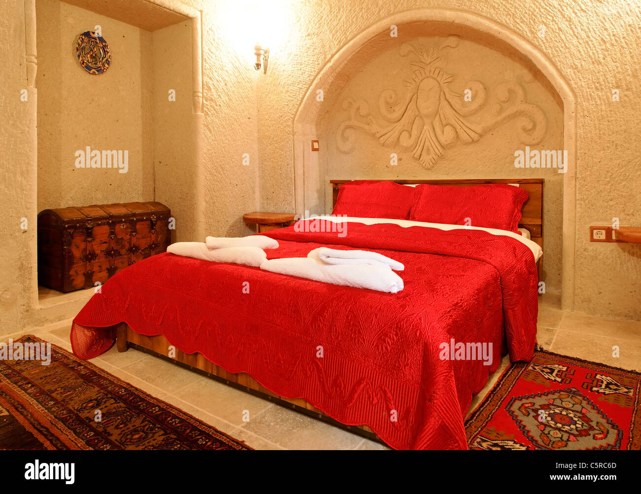 Interior Architectural Detail Of Bedroom With Alcove And Archway Detailing, Red  Bed Cover In Embroidered Bright Red Bedspread
