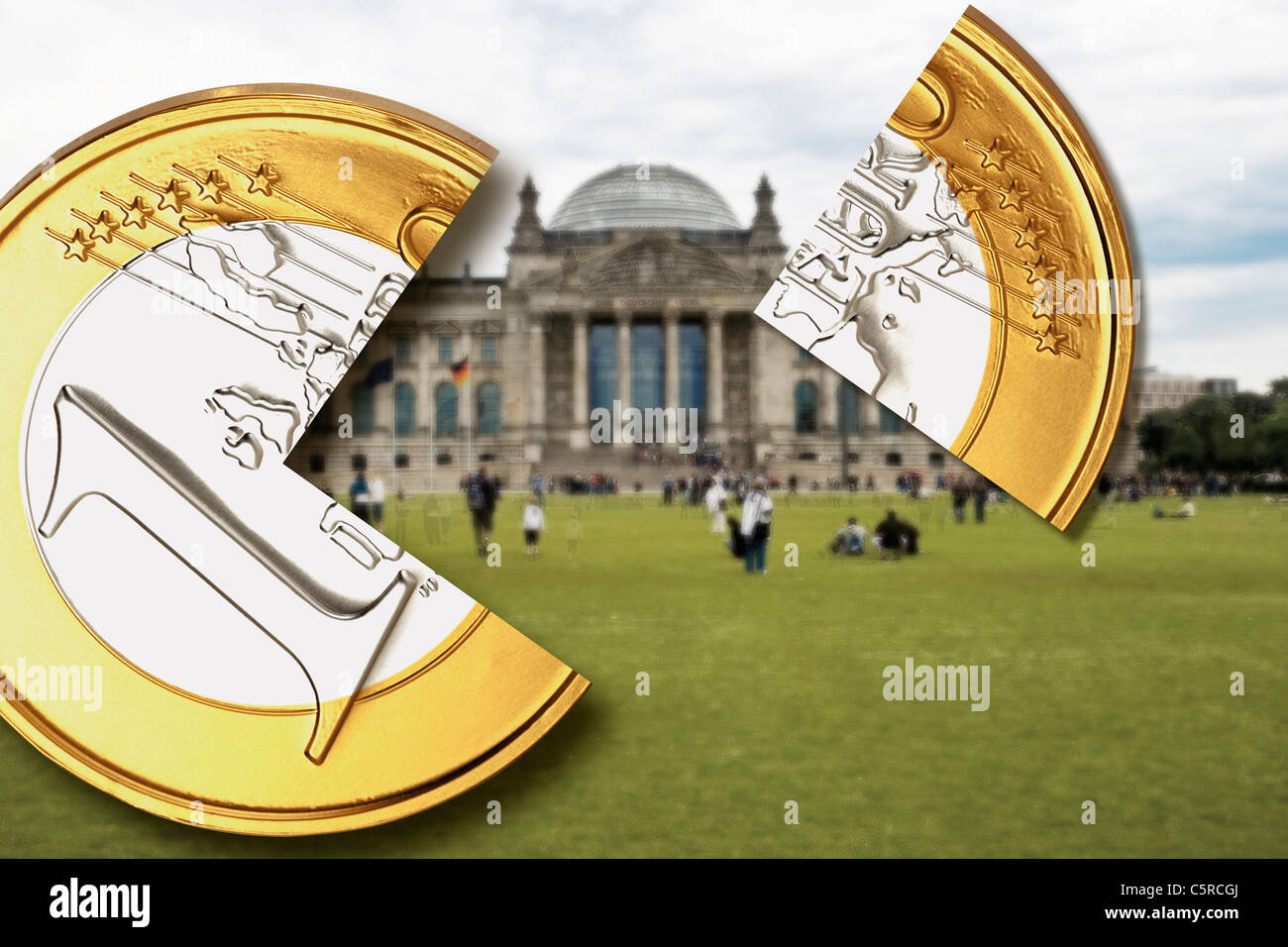 Germany, Berlin, One Euro coin with quarter piece in front of German Bundestag building - Stock Image