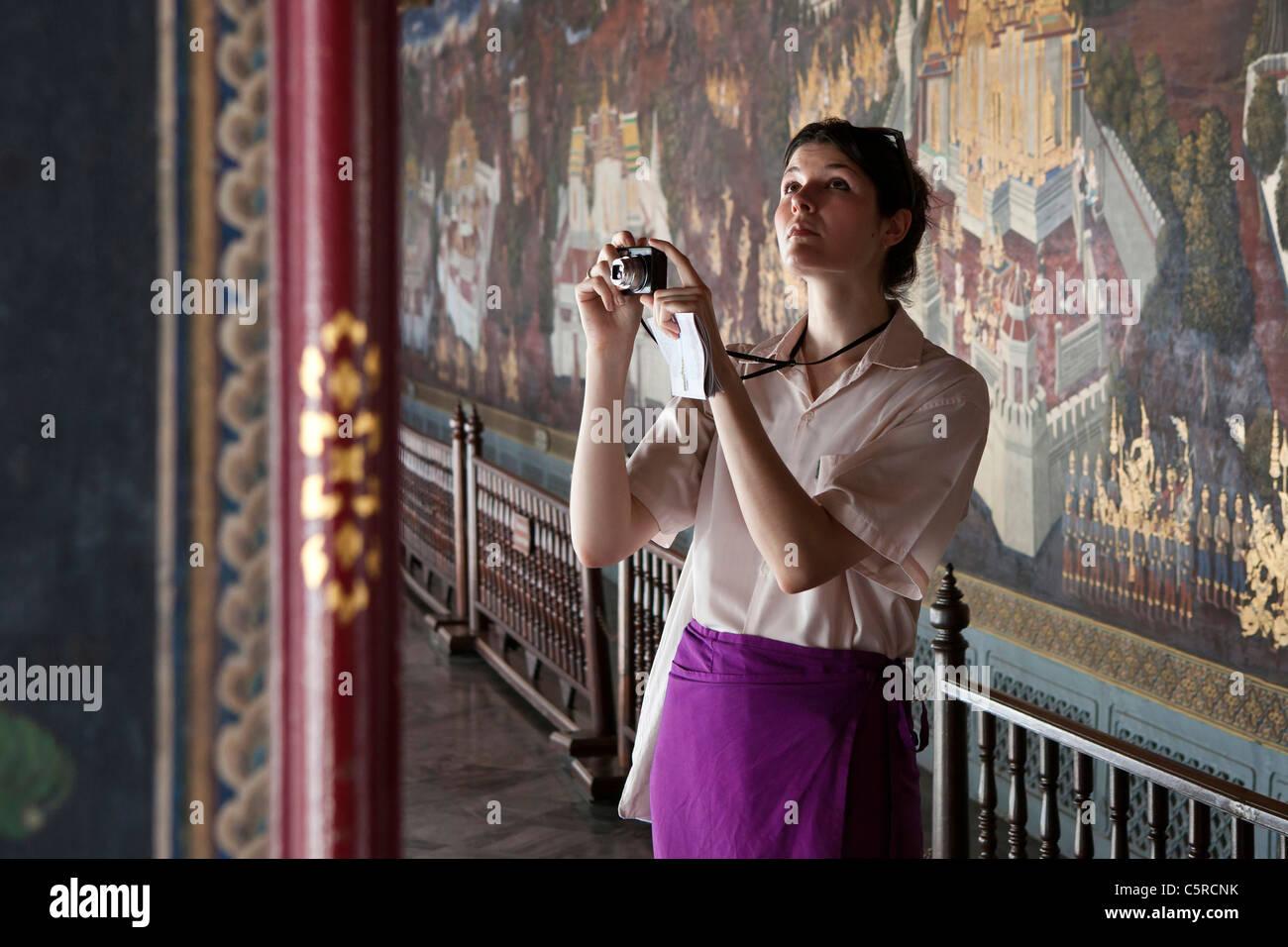 Tourist taking photographs in The Grand Palace, Bangkok, Thailand Stock Photo