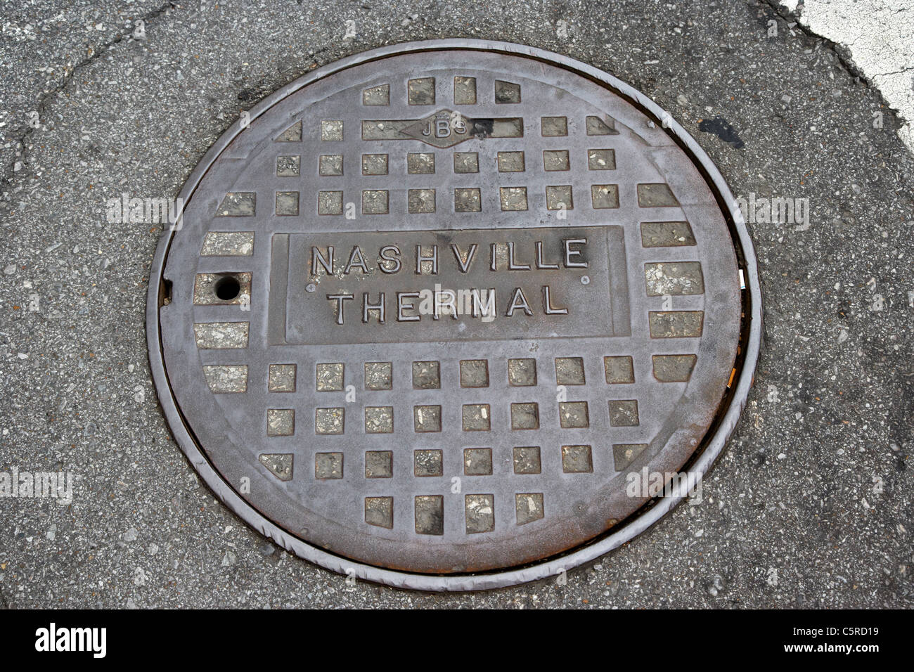 Nashville thermal manhole cover in the road Tennessee USA - Stock Image
