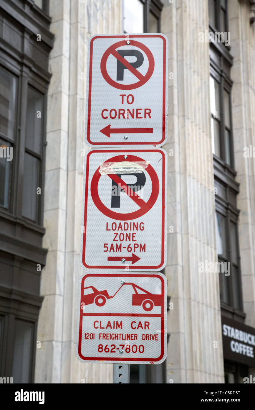 no parking signs and loading zones and towaway claim car number signs Nashville Tennessee USA - Stock Image