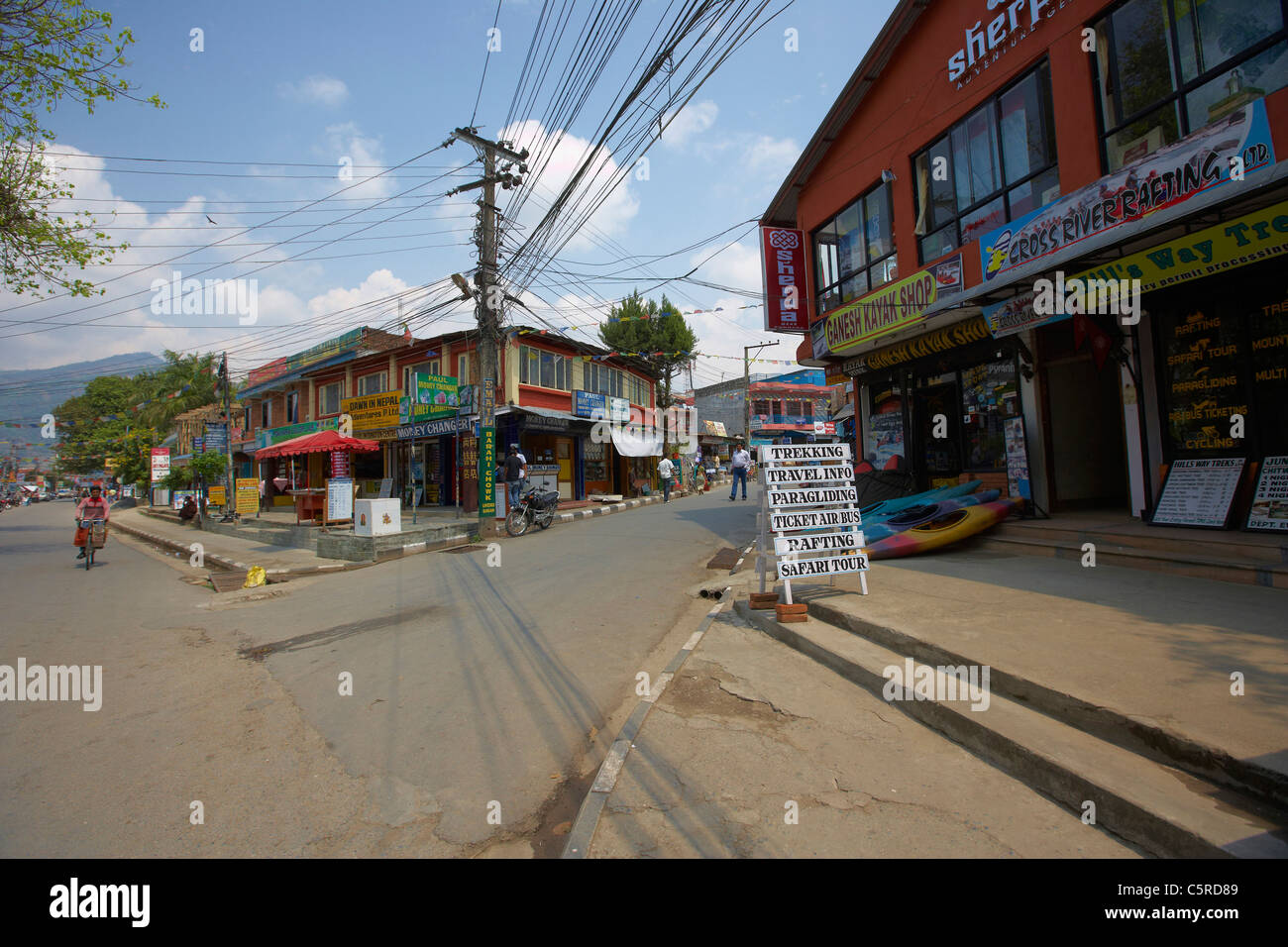 Street scene, advertising on Pokhara lakeside, Nepal, Asia - Stock Image