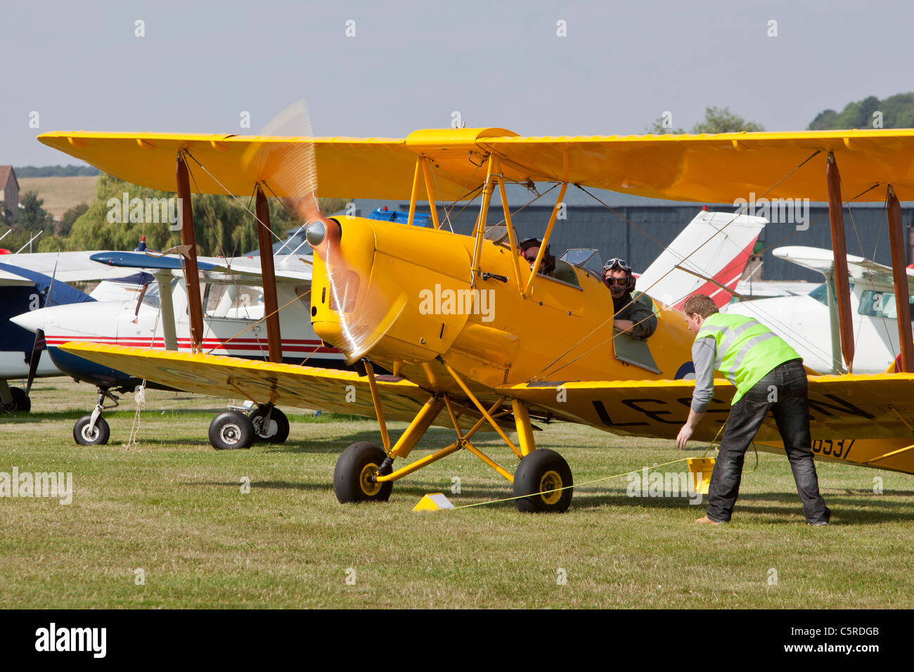 DH82 Tiger Moth biplane ready for take-off. Netherthorpe aerodrome, UK - Stock Image