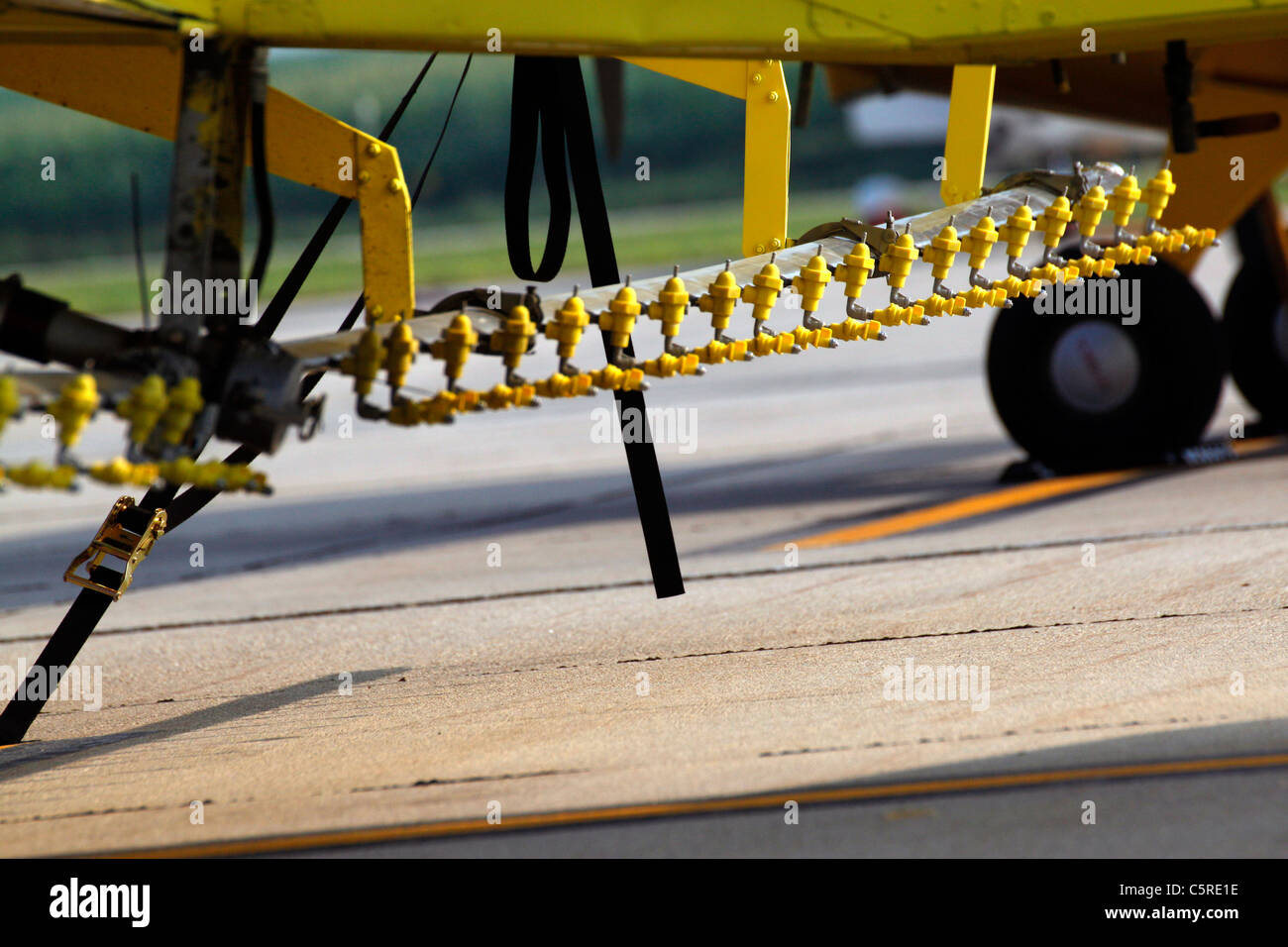 Spray nozzles under the wings of an airplane used in aerial application of agricultural chemicals Stock Photo