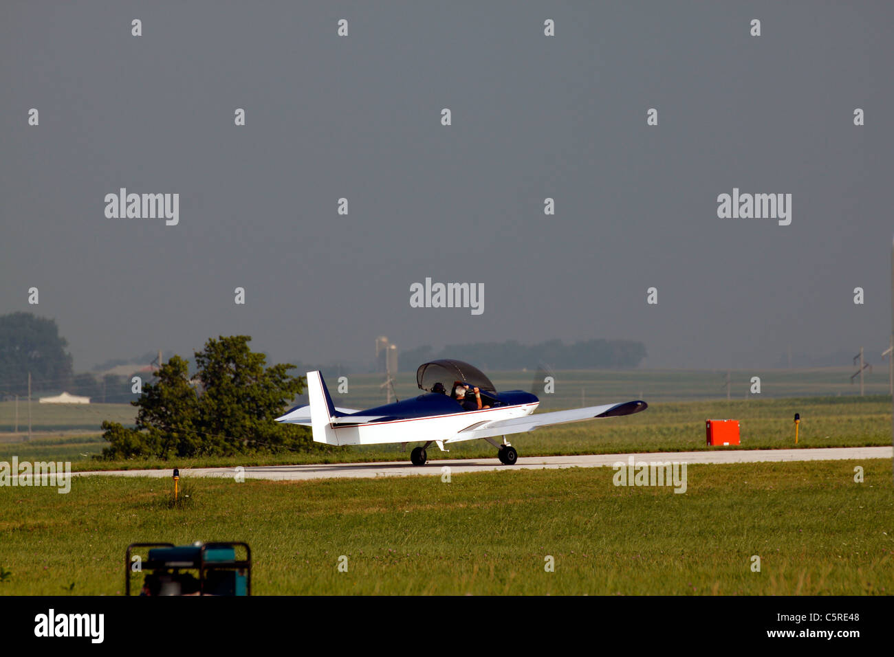 Aircraft preparing to take off in approaching stormy weather - Stock Image