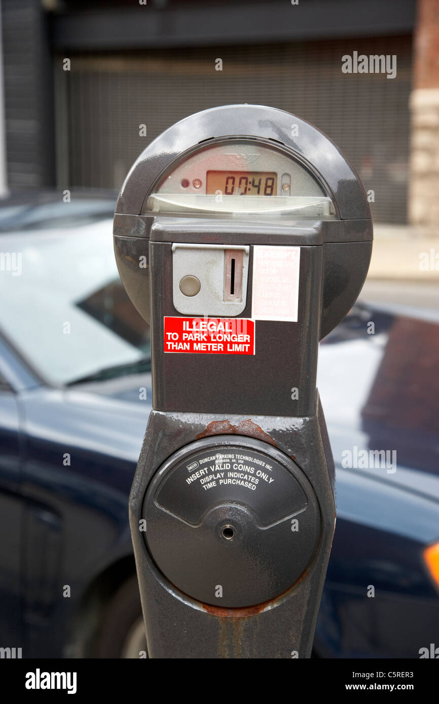 coin operated parking meter with time left in downtown Nashville Tennessee USA - Stock Image