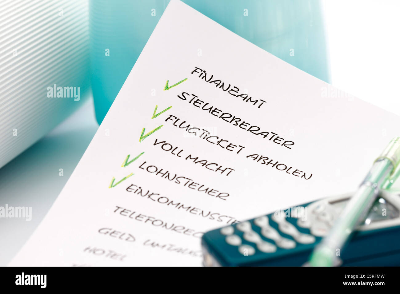 To Do List, ballpen and mobile phone, close-up - Stock Image