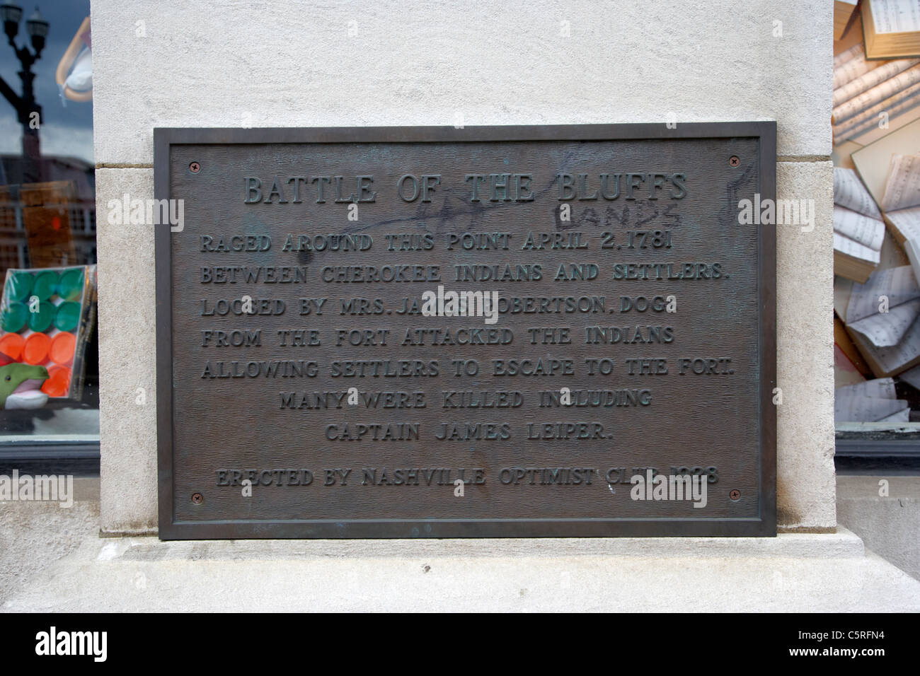 plate commemorating the battle of the bluffs defaced with the word bands Nashville Tennessee USA - Stock Image