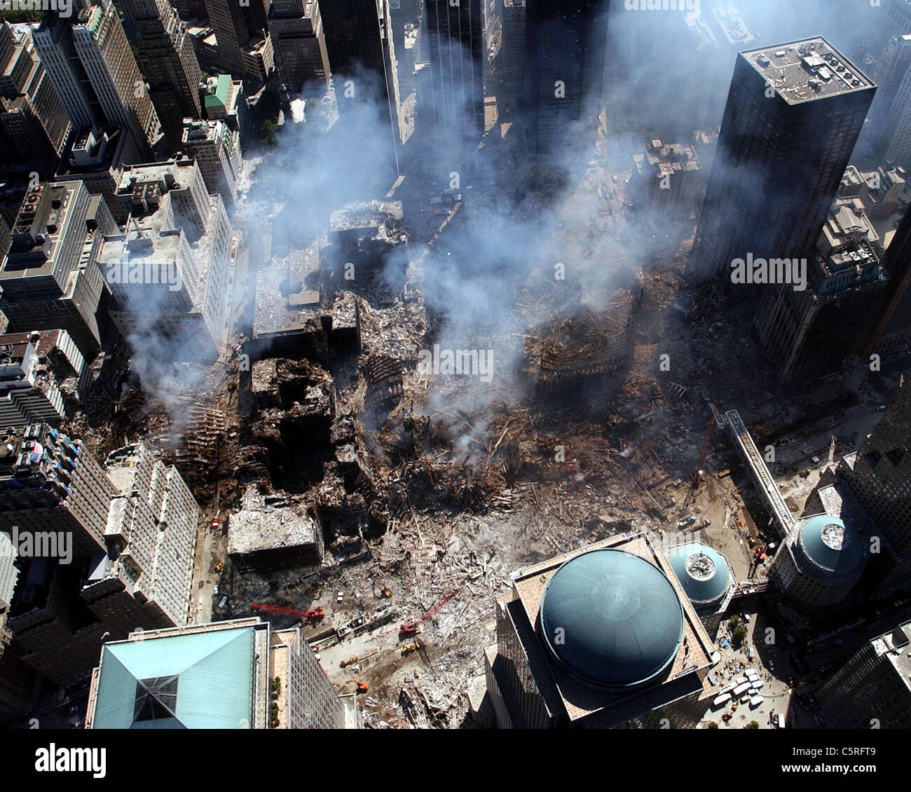Aerial view of smoking ruins of ground zero, the World Trade Center following the 911 terrorist attacks - Stock Image
