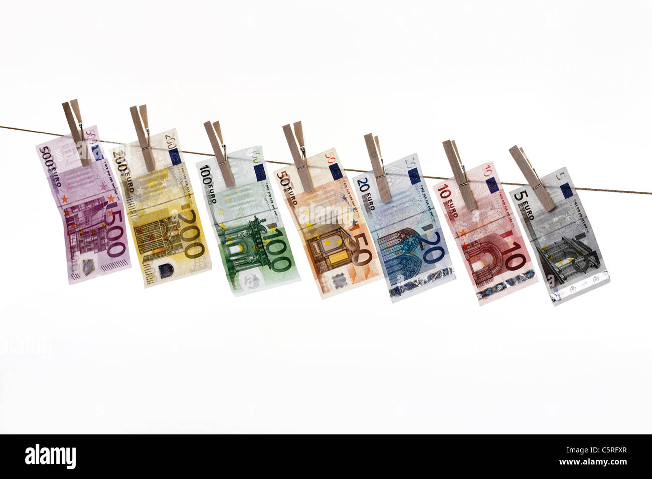 Different Euro bank notes hanging on clothesline Stock Photo