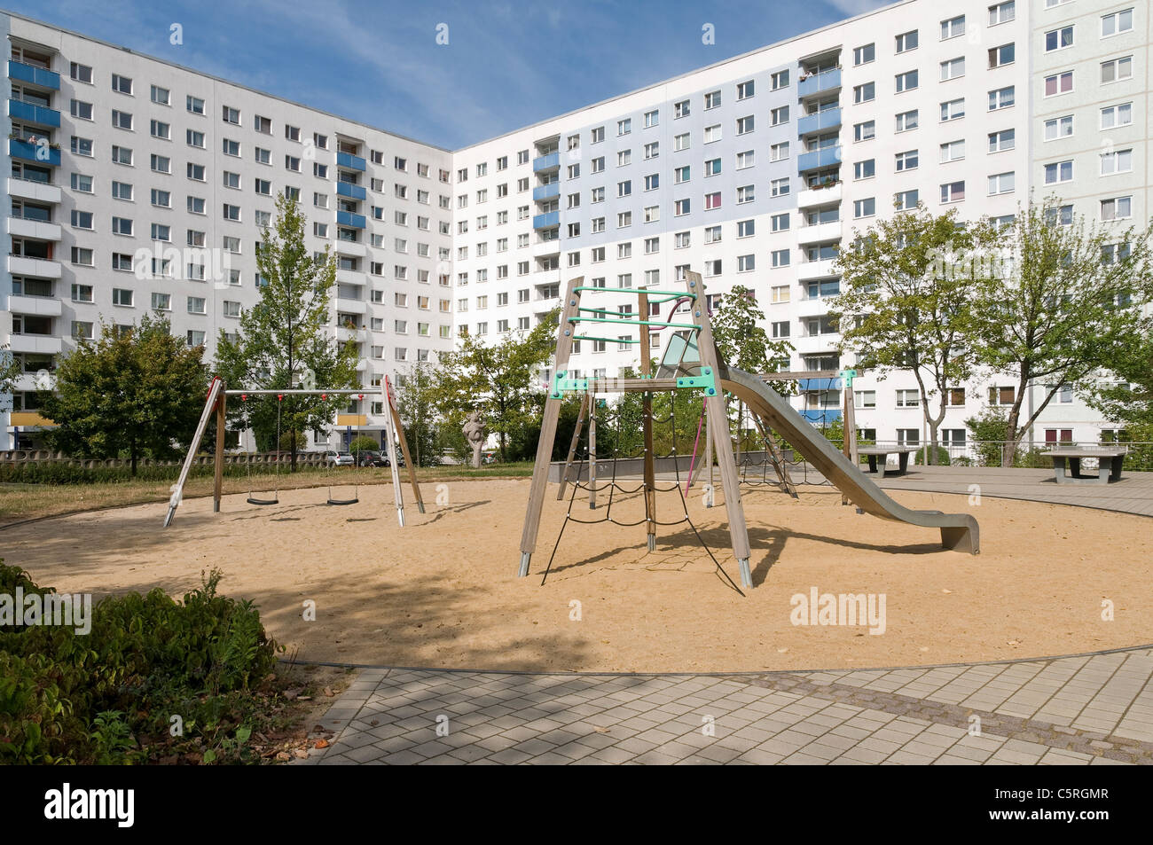 Empty playground, Plattenbau, pre-fabricated concrete buildings, social housing, residential estate, Jena, Thuringia, - Stock Image