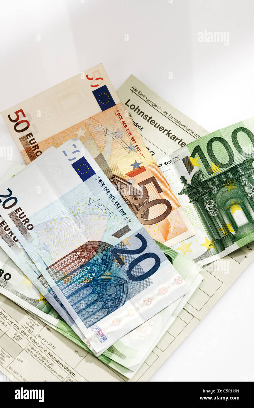Tax card, Euro coins and Euro bank notes in wage packet, elevated view - Stock Image