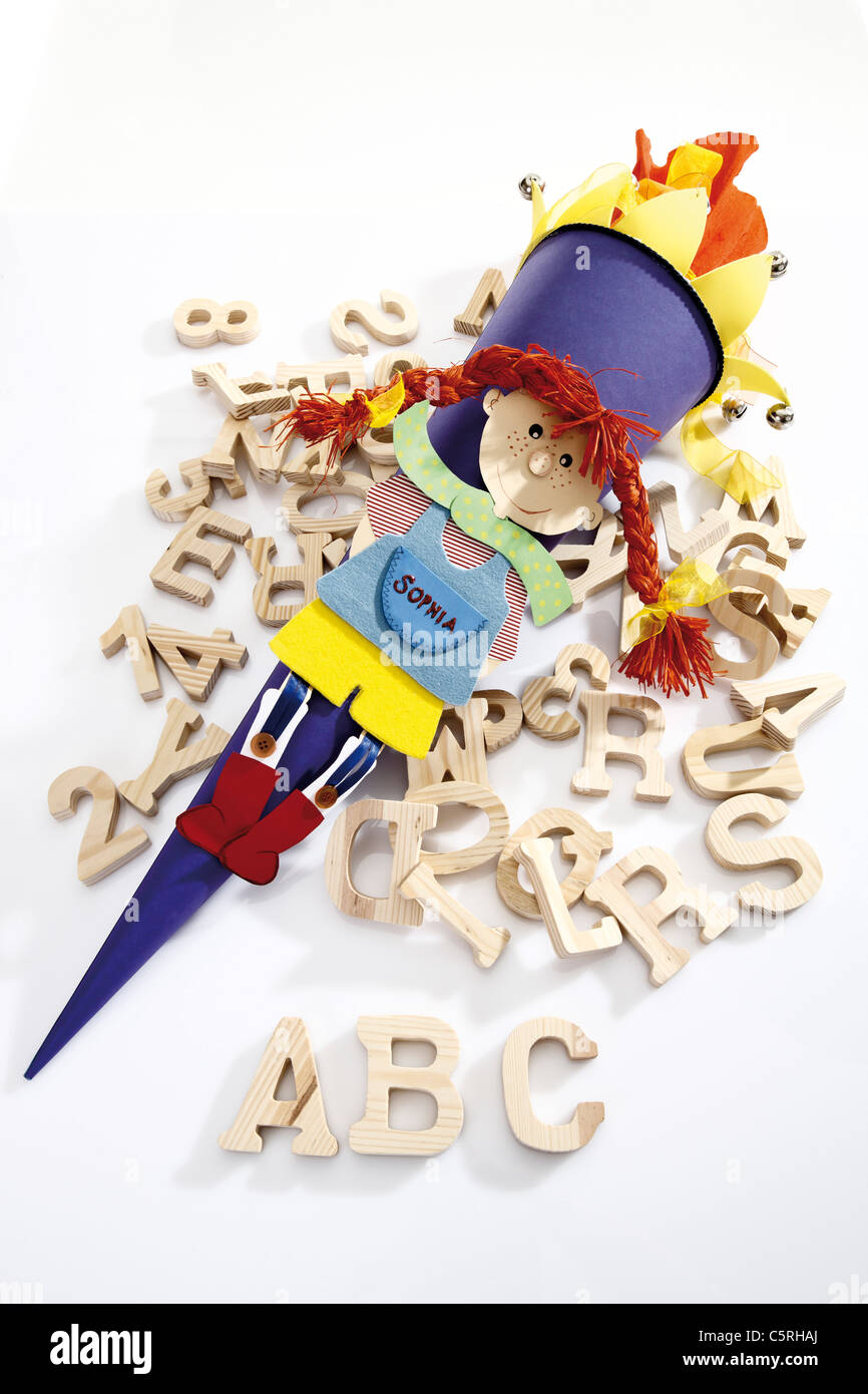 Colourful school cone and capital letters, elevated view - Stock Image