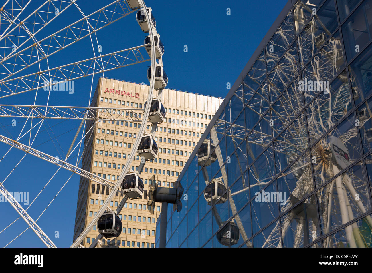Wheel of Manchester and Arndale Centre, England - Stock Image