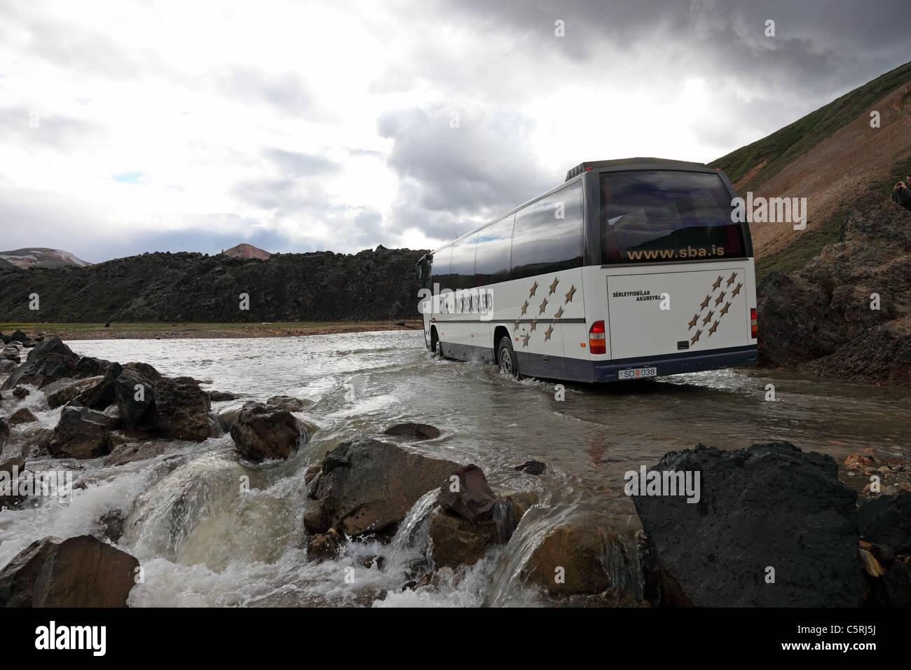 Bus Driving Through the River Namskvisl at Landmannalaugar in the Fjallabak Area of Iceland - Stock Image