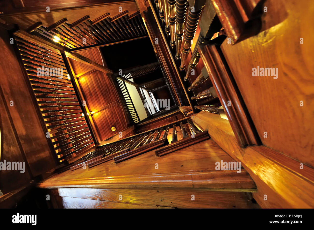 Mohonk Mountain House, interior view of rectangular spiral central wood staircase stairwell, NY, USA, 2010 - EDITORIAL Stock Photo