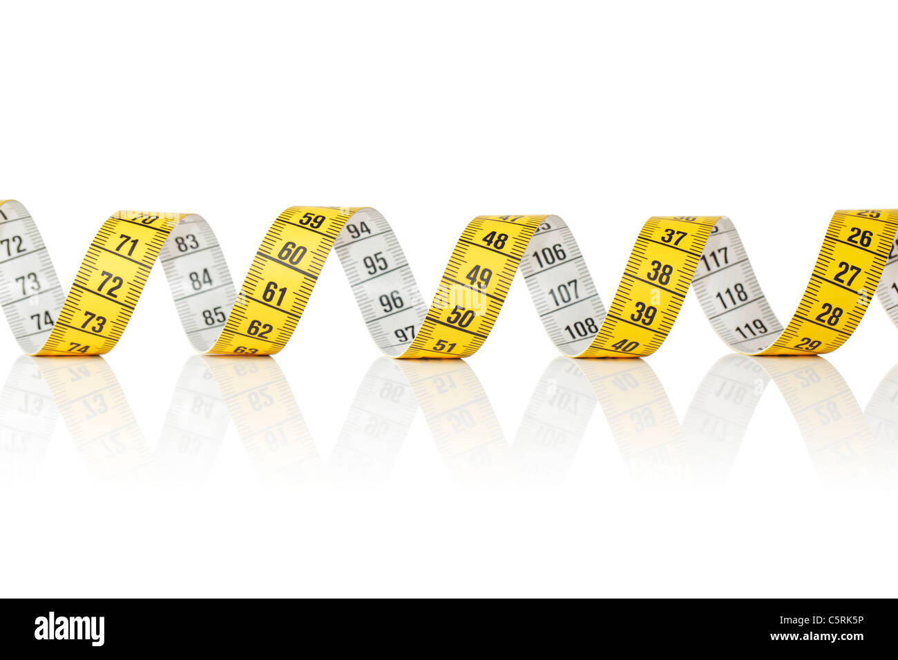 Yellow and white metric tape measure on white reflecting background Stock Photo